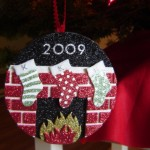 Create this cozy fireplace and stocking ornament by using sticky-back foam sheets and stocking stickers!