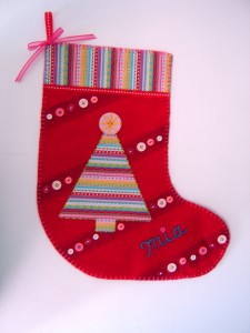 With Mia's stocking I added a cute little pink ribbon just below the hanger loop and did her name in contrasting blue embroidery floss!