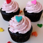 These super-moist chocolate cupcakes with cherry cream cheese frosting will show the whole family how much you love them this Valentine&#039;s Day!