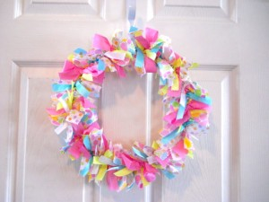 Choosing pastel-hued fabric strips make your rag wreath a easy Easter decorating craft idea.