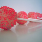 Using neon sprinkles make these strawberry pops POP!  These would be perfect for a girl's pirthday party or a baby shower!