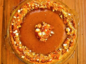 Create a pumpkin masterpiece by garnishing it with a mixed nut brittle. Warning: you may need to arrange for a plain version for the kiddos!